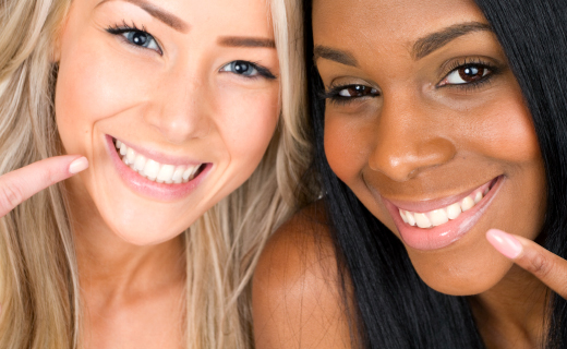 dca-blog_teeth-whitening-two-women-pointing